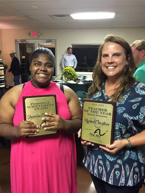 Jazmine and Ms. Rachel pose holding their awards.