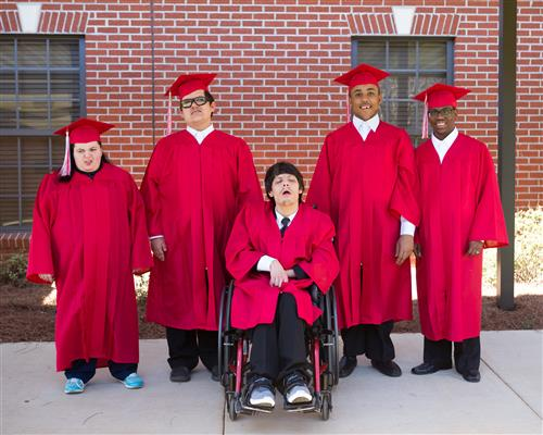 5 students in graduation gowns