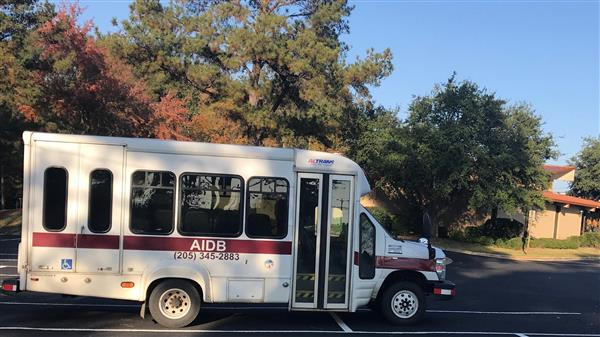The AIDB bus sitting in the parking lot in front of the Tuscaloosa Regional Center