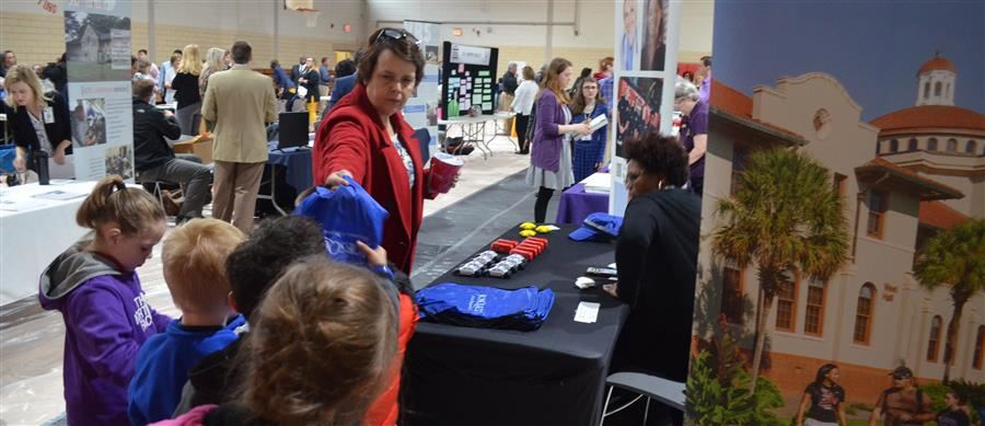 Students visit booths at ASD's career day.