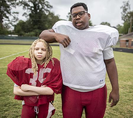 Two ASD football players pose for a photo during practice