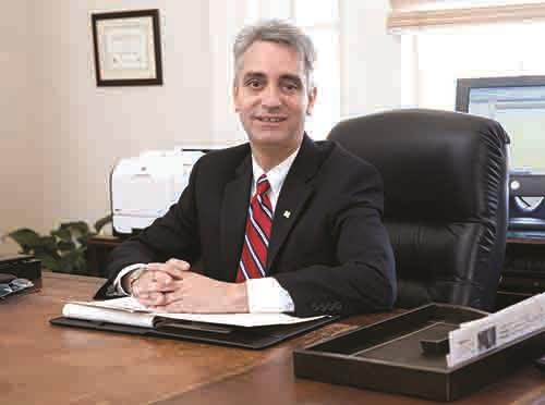 Photo of AIDB President Dr. John Mascia siting at his desk in Manning Hall