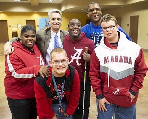 Photo of AIDB President Dr. John Mascia with five Helen Keller School students