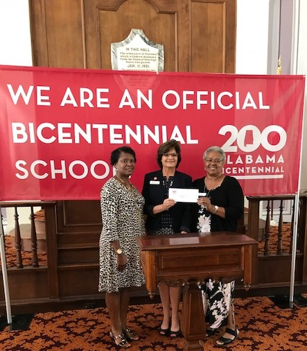 From left to right, Sandra Ware, Elizabeth Ponder and Vera Hendrix display the bicentennial school grant check.