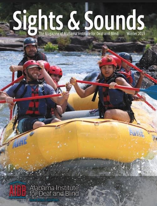 Front cover of the Sights and Sounds magazine showing a group of ASB students white water rafting