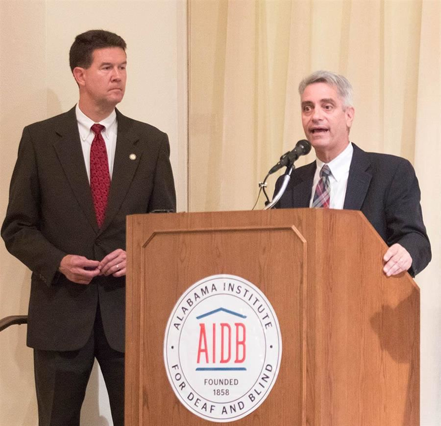 Alabama Secretary of State John Merrill and AIDB President Dr. John Mascia onstage at ASB