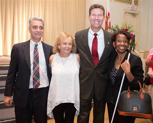 Dr. John Mascia, Joan Garrett, John Merrill and Barbara Manuel pose for a photo at ASB.