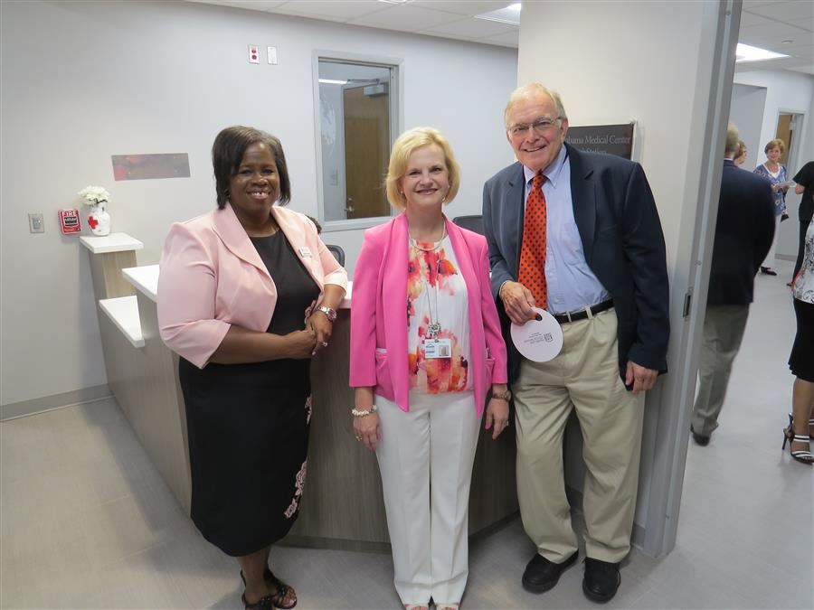 Photo of Executive Director Karissa Twymon and two other donors to the clinic