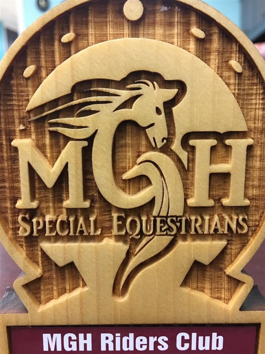 Wood carved trophy with MGH Special Equestrians logo and MGH Riders Club plaque
