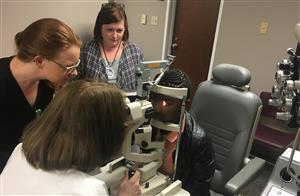 Doctor examining student in Low Vision clinic